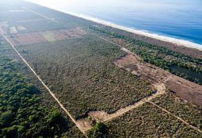 Foto de terreno habitacional en venta en laguna manialtepec , puerto escondido centro, san pedro mixtepec dto. 22, oaxaca, 17892380 No. 01