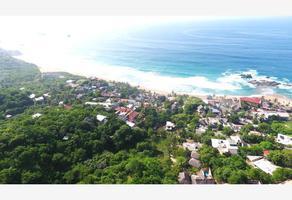 Foto de terreno habitacional en venta en s/nombre um, puerto angel, san pedro pochutla, oaxaca, 16852652 No. 01