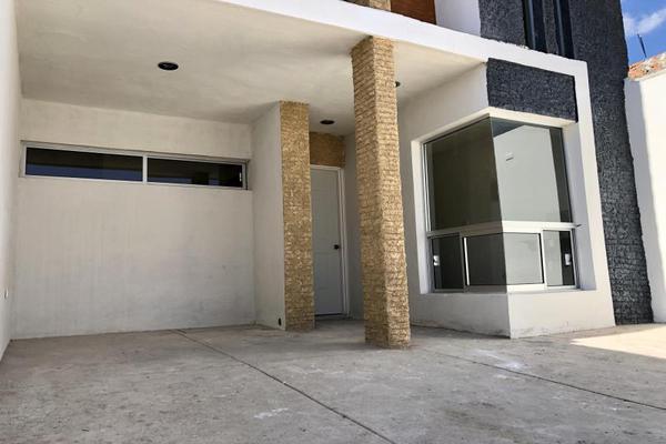 Foto de casa en venta en  , fraccionamiento san miguel de casa blanca, durango, durango, 13382854 No. 02