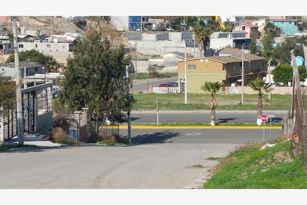Foto de terreno habitacional en venta en calle martin moreno y boulevard hinsense 0, benito juárez, playas de rosarito, baja california, 6160229 No. 02