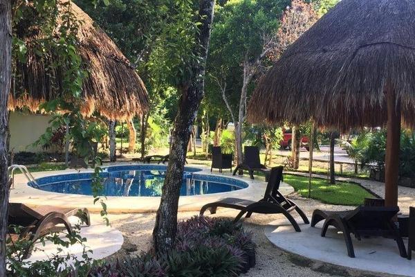 Foto de terreno habitacional en venta en  , puerto morelos, benito juárez, quintana roo, 7960856 No. 01